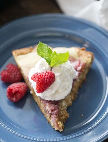 The raspberry amaretto cheesecake topping to this easy skillet blondie is like a dessert all on it's own!