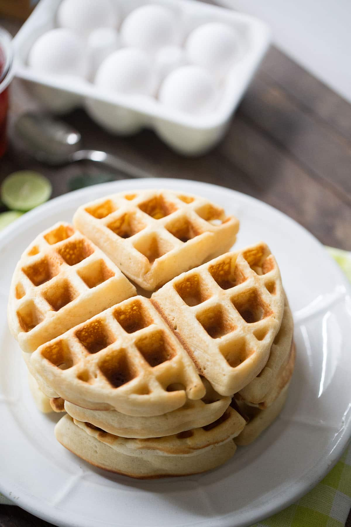Homemade Belgian waffle recipe that is perfect for summer; fresh key lime flavor and sweet strawberries make this breakfast unbelievable!