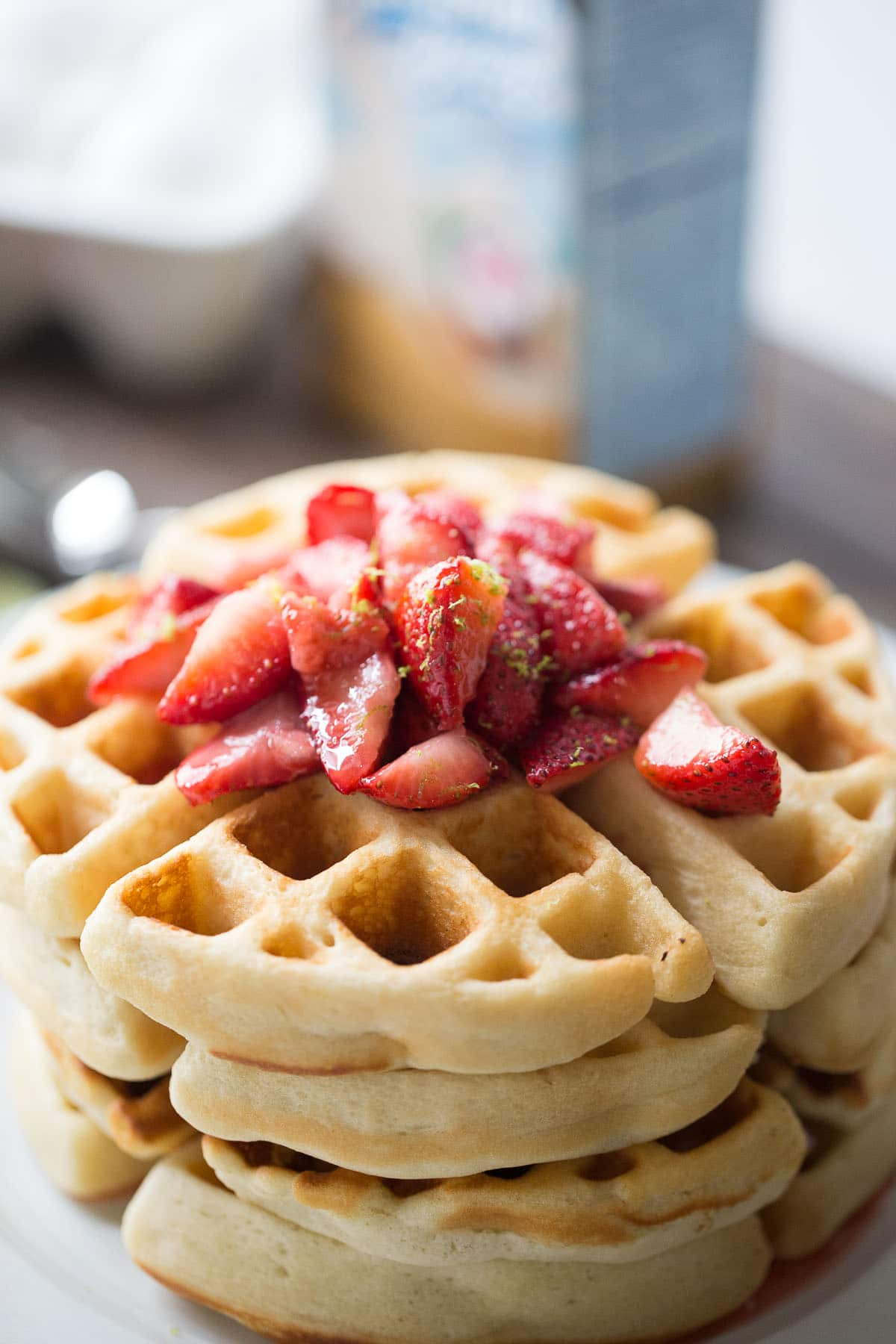This key lime Belgian waffle recipe with it's fresh strawberry sauce are perfect for special occasions or lazy mornings!