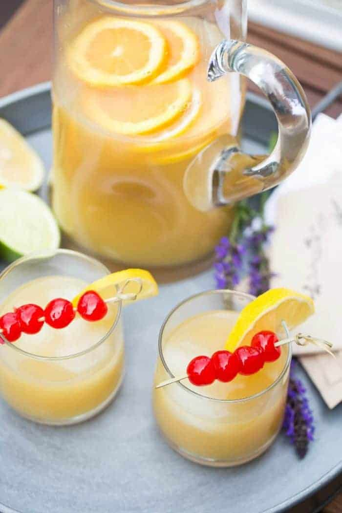 This easy whiskey sour party punch recipe gives the classic cocktail, a modern, summery this!