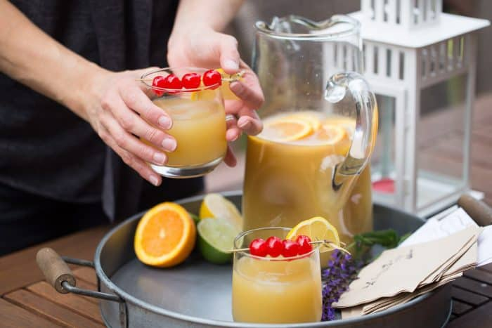 This party punch recipe is a fun, citrusy twist on the classic cocktail! This punch will liven up any party!
