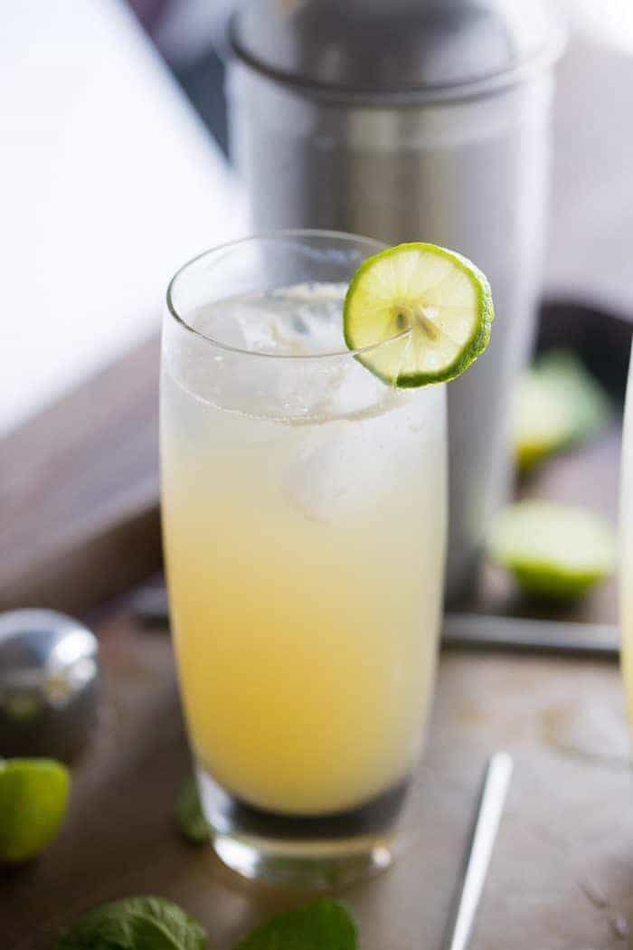 A vodka Collins with a key lime garnish