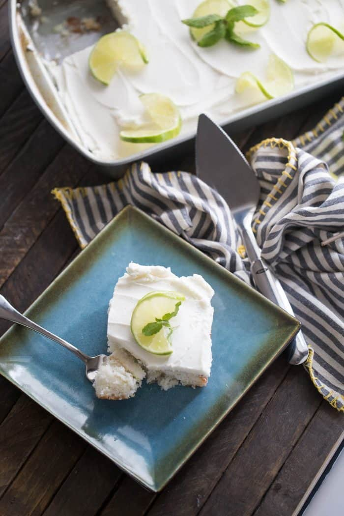 Mojito meets cake in this simple dessert recipe! A rum flling is soaked into fluffy white cake and then topped with a minty buttercream frosting!