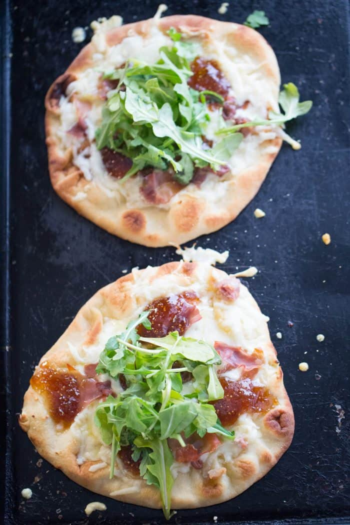 Naan Pizza is made by topping naan bread with creamy fontina cheese, salty prosciutto and sweet fig jam. The combination is sensational!   Recipe on lemonsforlulu.com