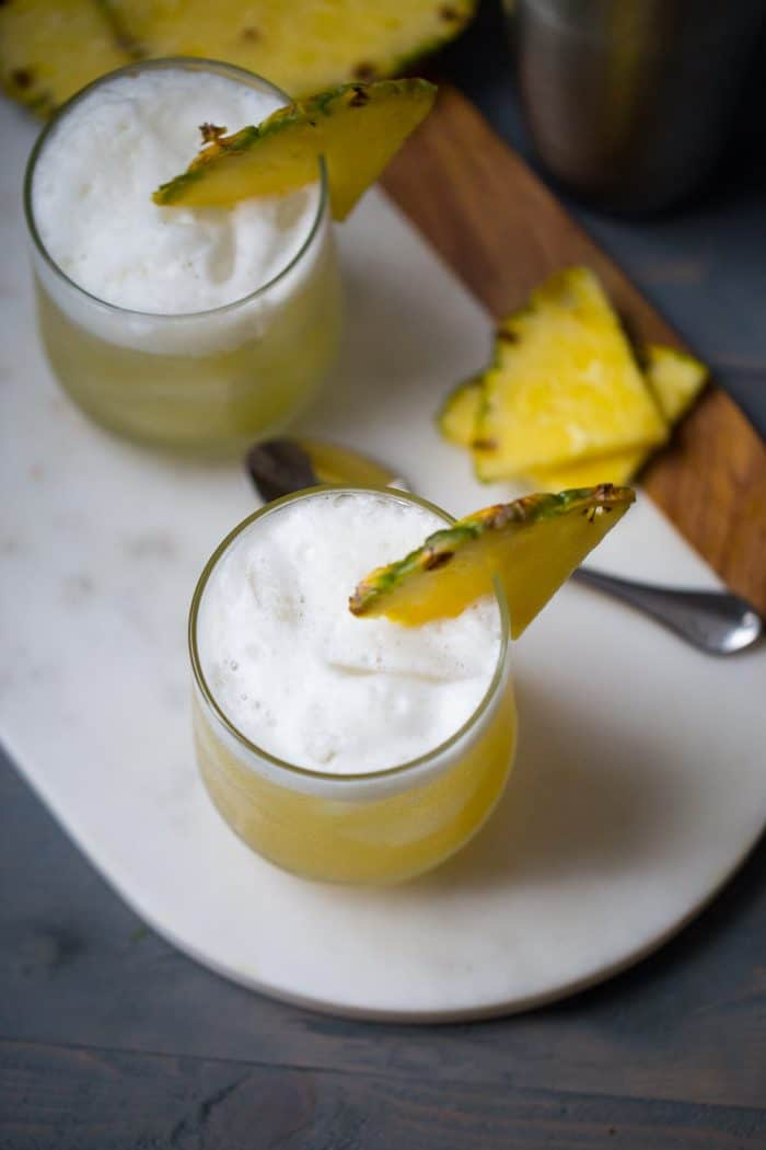 Pineapple Bourbon Punch - Bourbon, sweet pineapple juice, and hazelnut liqueur are shaken together for a tropical tasting drink. | Cocktail recipe from lemonsforlulu.com