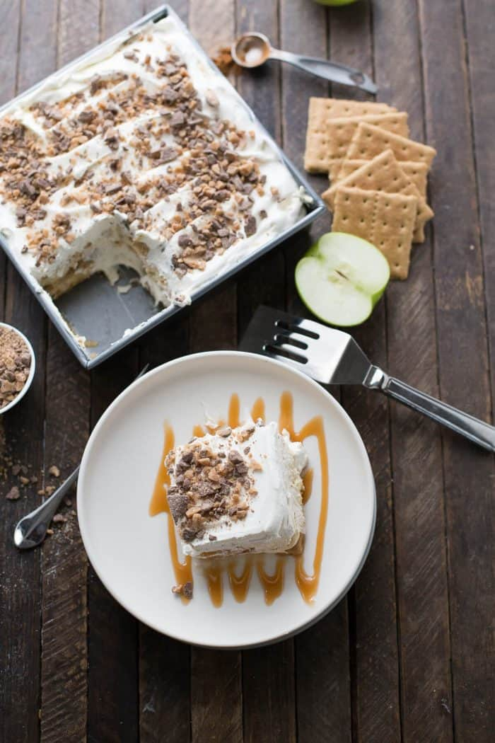 "This eclair cake is like apple pie but better! Graham crackers are the ""cake"" layers that are held in place with apple pie filling and apple spiced pudding. Toffee bits crown the top!"