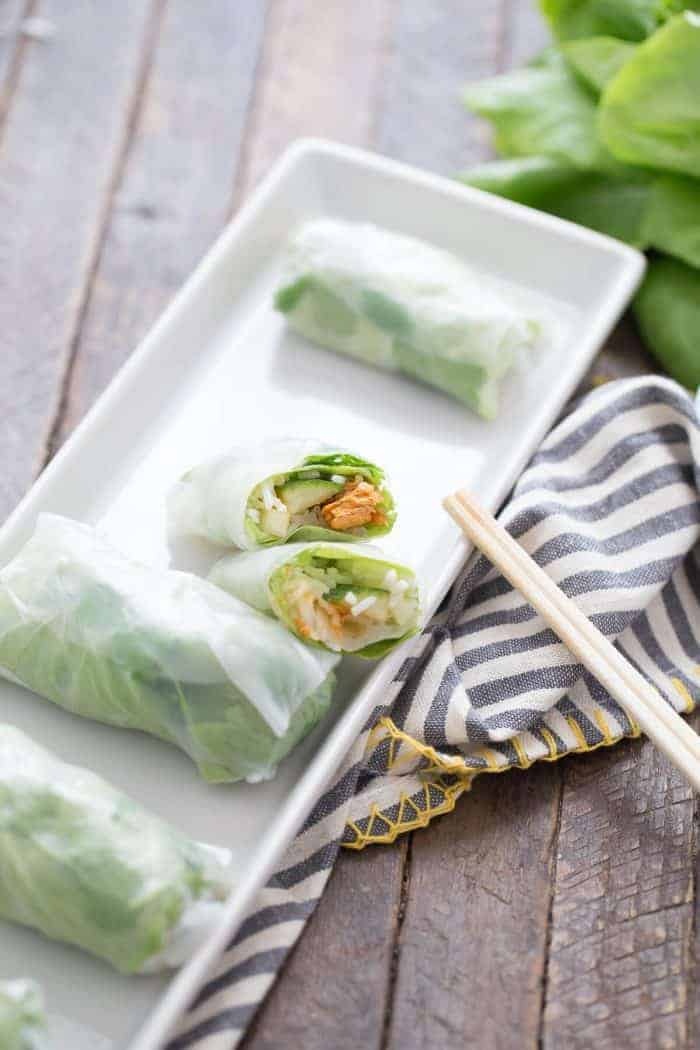 Springs rolls are so simple to make! These rolls have veggies, rice and a sweet and spicy salmon filling!