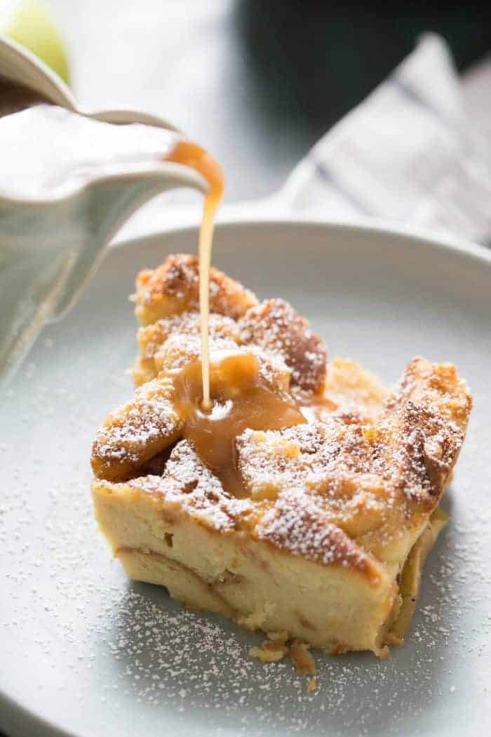 Tender sweet bread and cinnamon apples makes this bread pudding recipe taste amazing! The caramel sauce on top is the crowning glory!