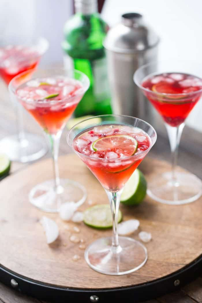 A gin fizz made with tart pomegranate juice and fresh limes! This cocktail is gorgeous AND delicious!