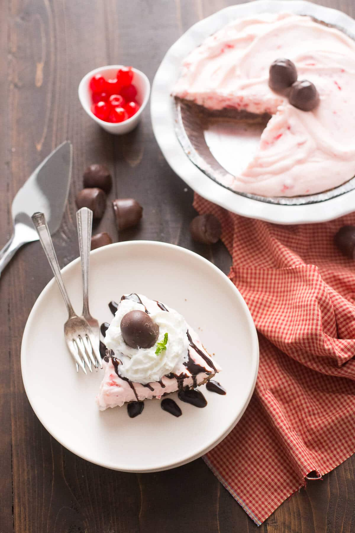 Cherry cream pie is a stunning dessert! This has a such a fluffly cherry filling that rests atop a decadant chocolate layer. It is sinfully good!