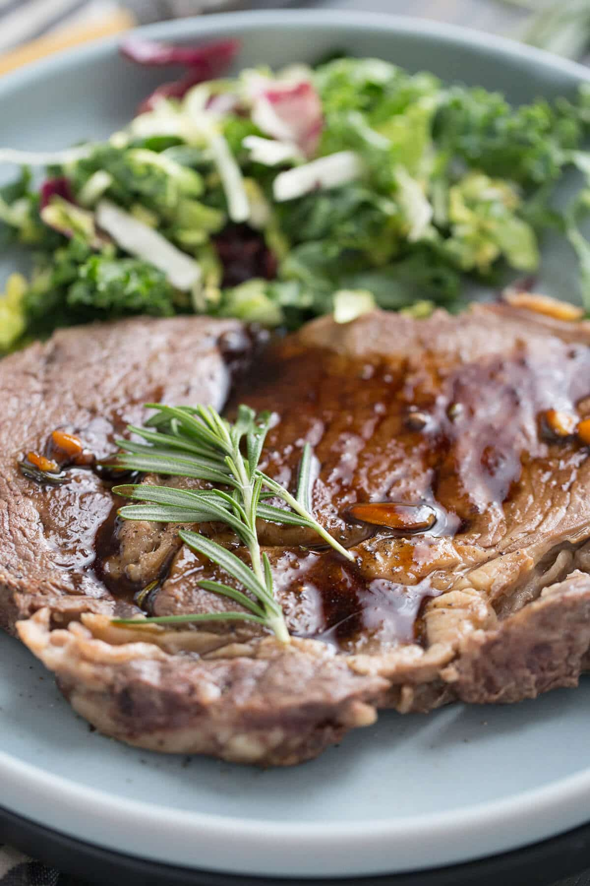 Ribeye steaks are lightly pan-seared then drizzled with a silky Kahlua sauce!