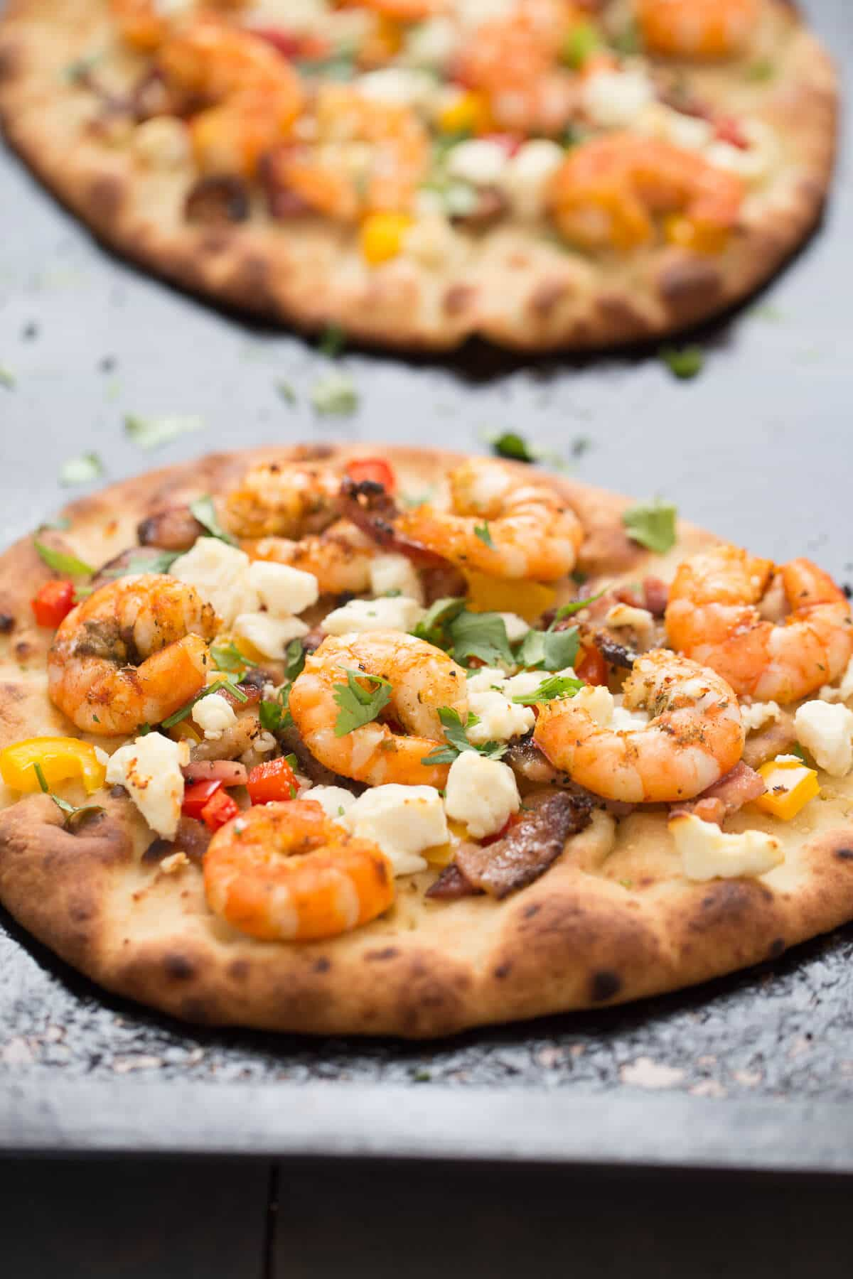 A Cajun shrimp pizza made a naan bread that takes minutes to make! Serve this as a meal or even as an appetizer!