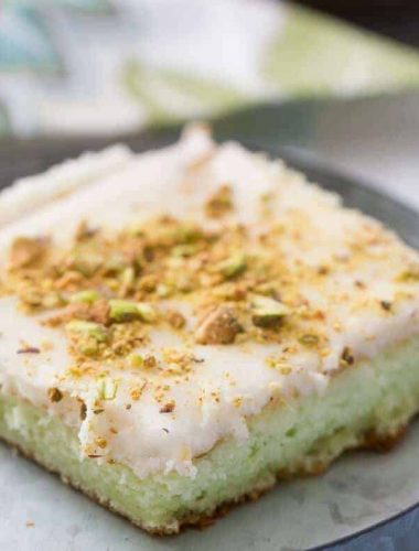 This pistachio pudding cake is simple and amazing! This cake just melts right in your mouth!