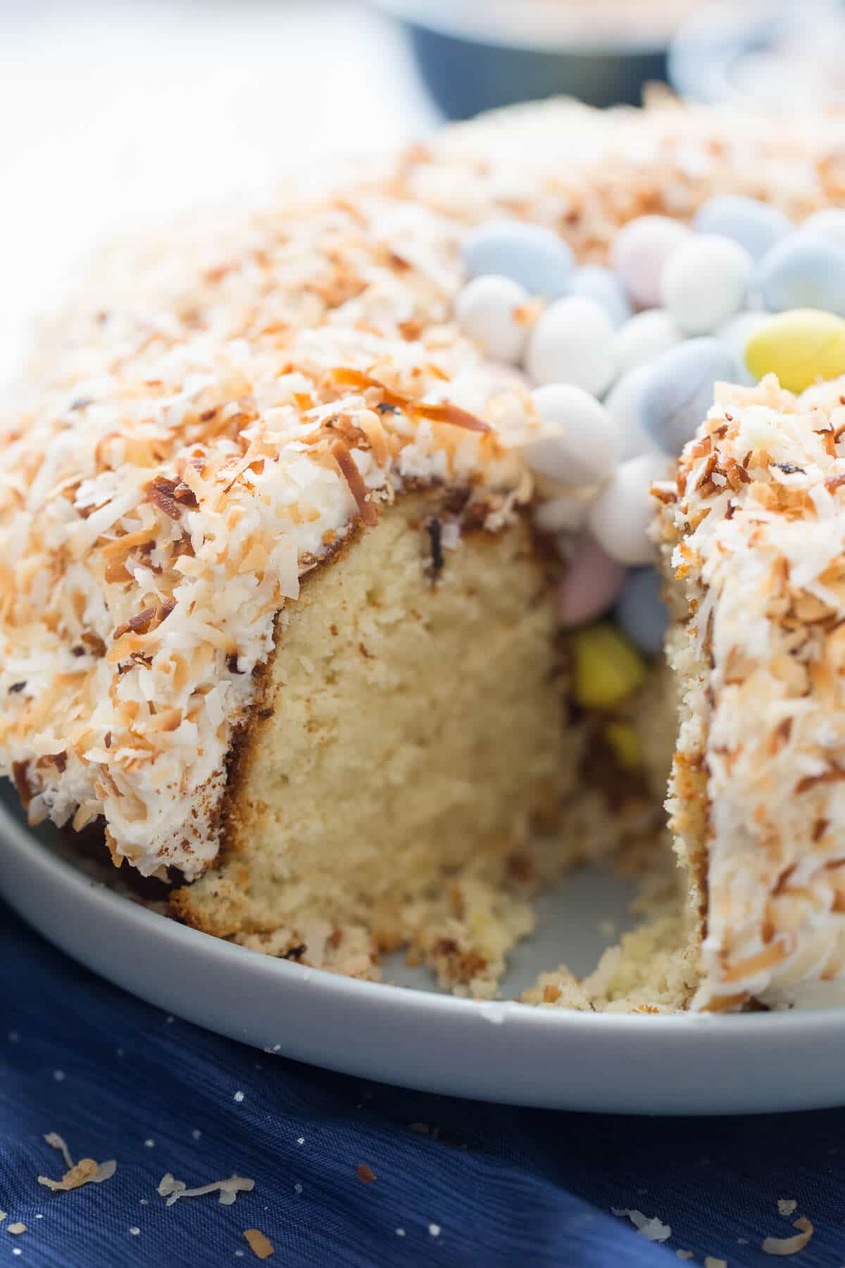This is one impressive Easter lemon bundt cake! Toasted coconut is arranged with chocolate eggs to look just like a birds nest!