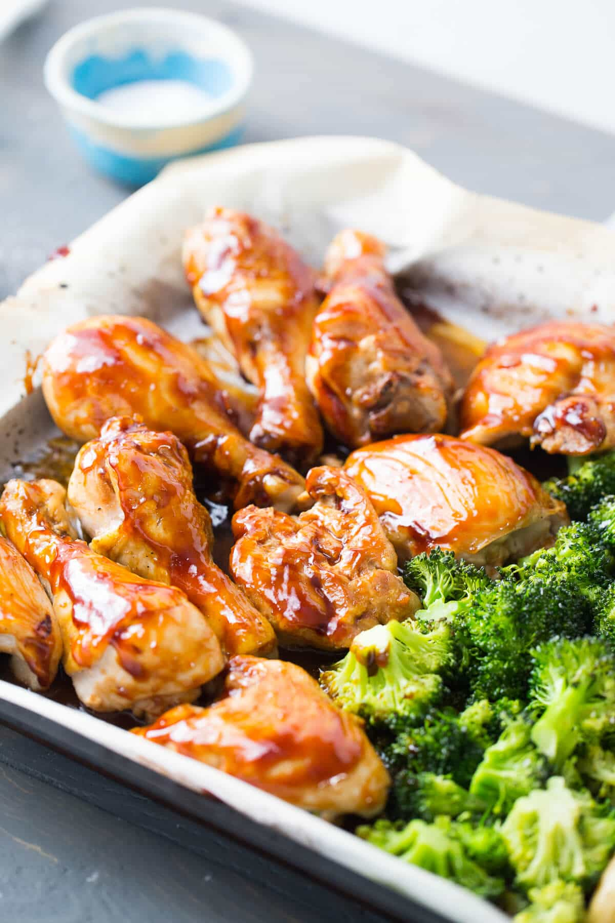 This sheet pan dinner is so simple and so good! The bourbon chicken recipe feature chicken coated with a sticky sweet bourbon glaze and served it with potatoes and broccoli!