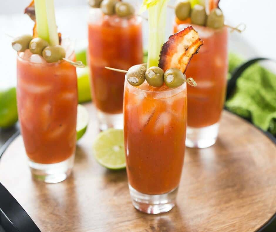 Buffalo sauce makes these Bloody Mary's extra special! Garnish these cocktails with blue cheese stuffed olives and bacon!