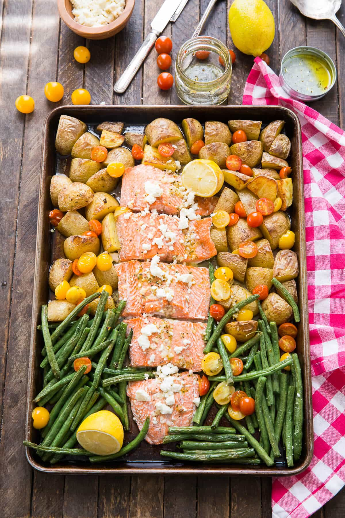 Love salmon and one pot meals? This sheet pan Mediterranean salmon is so good, this is the only salmon recipe you'll need!