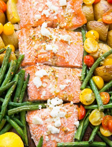 This Mediterranean salmon is baked simply with vegetables all in one sheet pan!