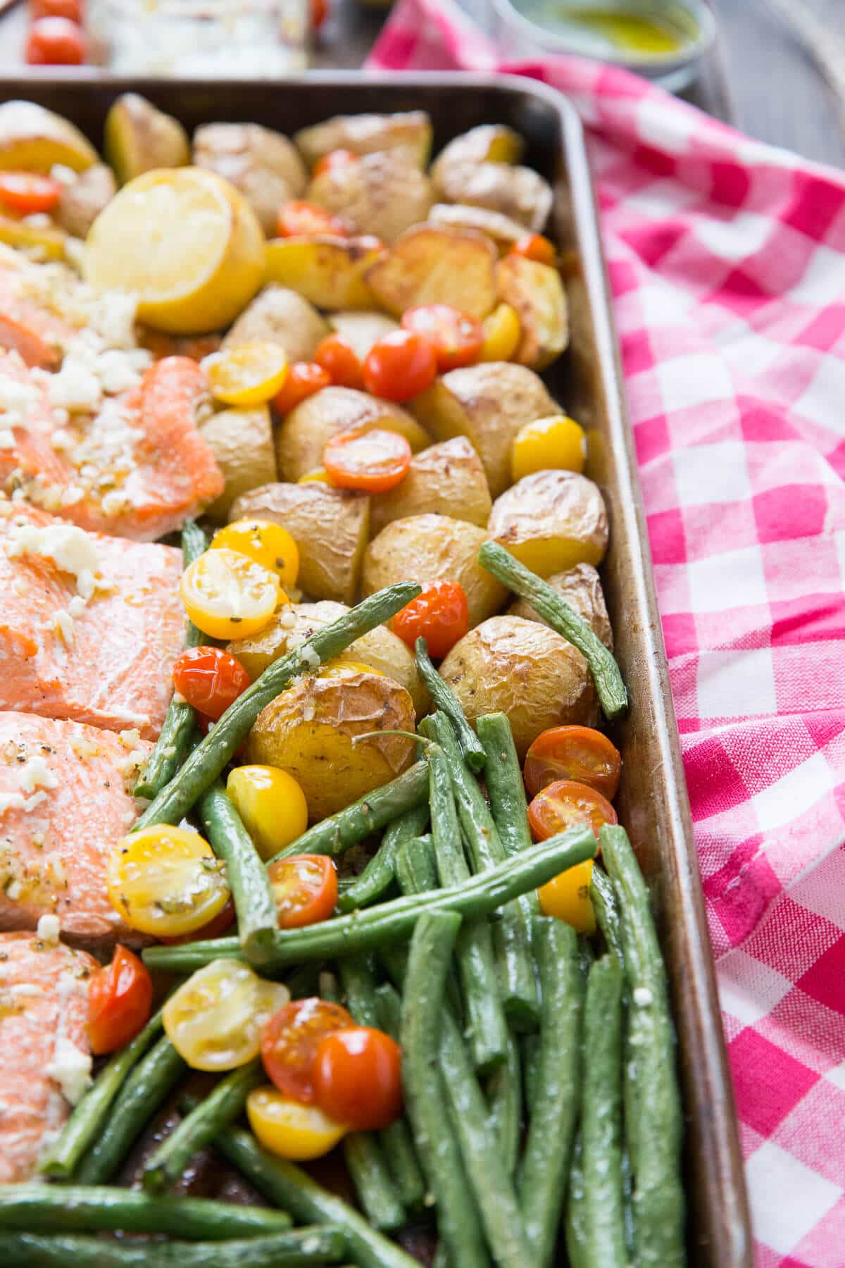 Mediterranean salmon is all baked in one sheet pan! It is ta great quick meal with only a little clean up!