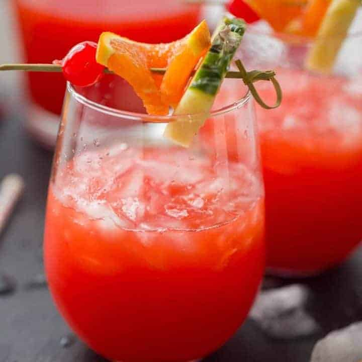 This rum punch recipe is going to be your drink this summer! It is so good!
