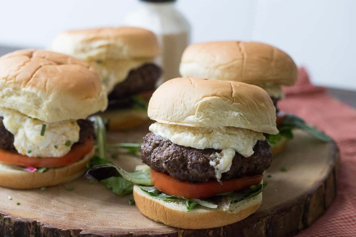 These juicy horseradish cheddar burgers are a must for your next BBQ! The creamy cheddar topping can practically be eaten with a spoon!
