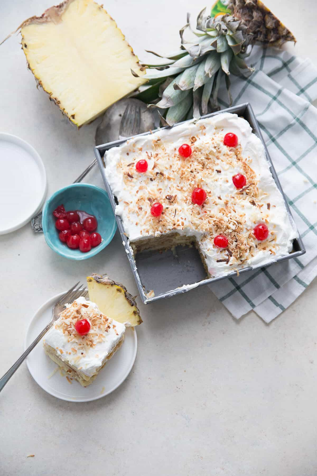 Love pina coladas? Then you will love the sweet pineapple filling and the coconut whipped cream in this easy no bake box cake