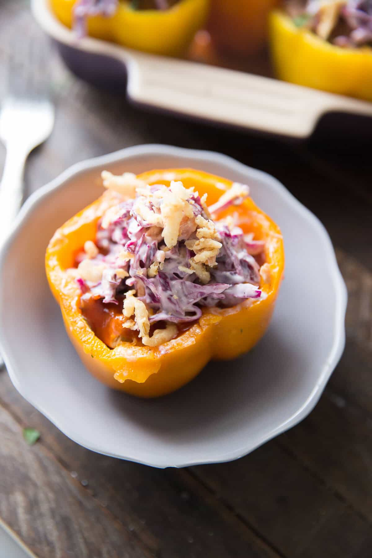 Southwest Stuffed peppers are filled with BBQ brisket and topped with a tangy slaw! The colors and the flavor pop!