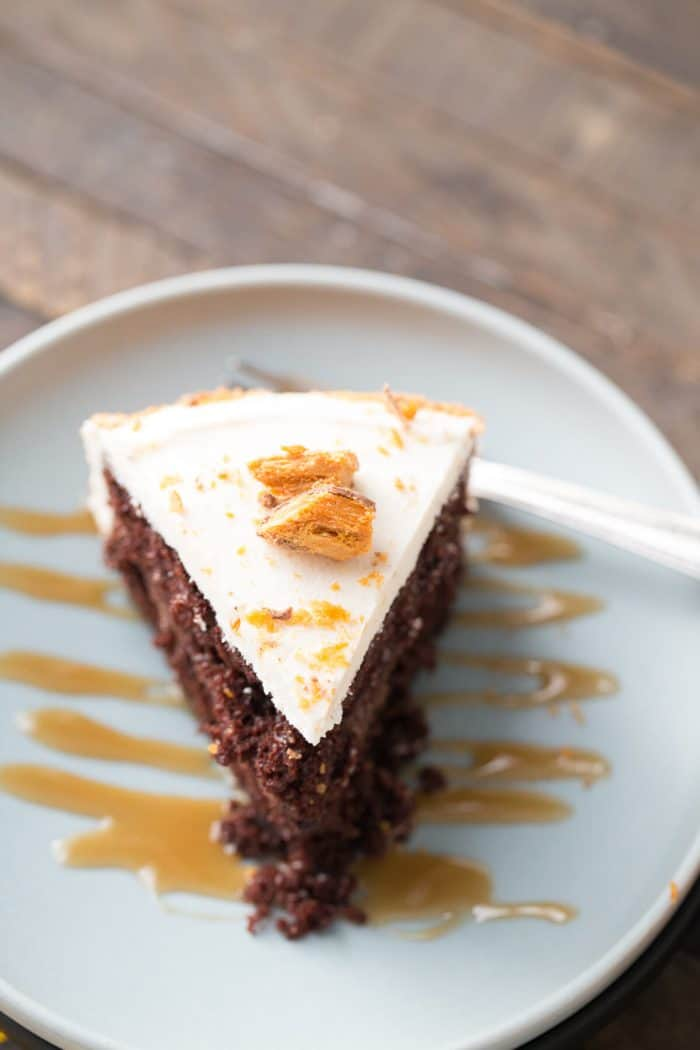 A piece of cake on a plate, with Butterfinger and Chocolate