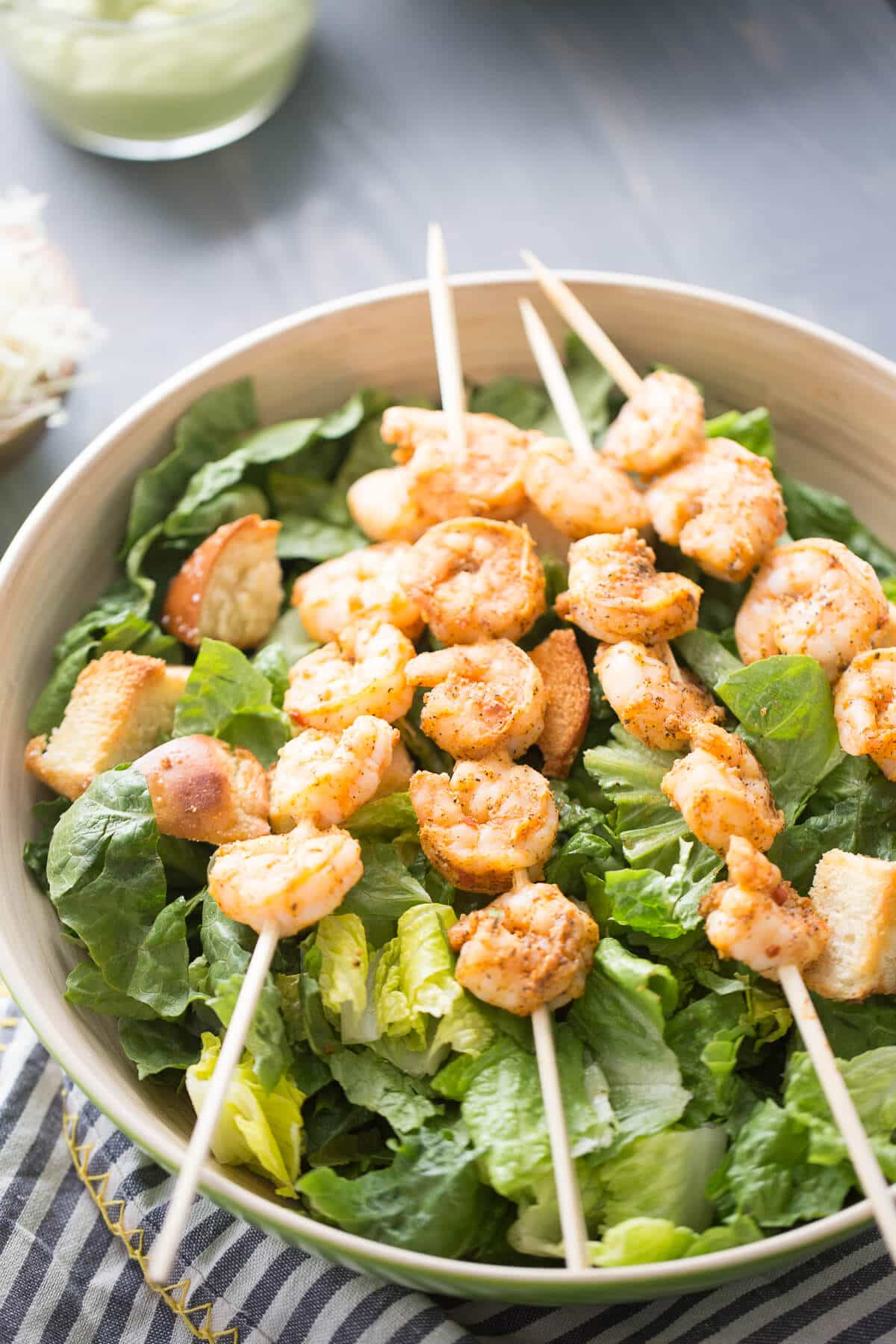 Crisp and cool lettuce is balanced by seasoned, grilled shrimp in this refreshing Shrimp Caesar Salad! Traditional Caesar salad dressing is replaced with an avocado dressing that adds just the right amount of creaminess to each bite!