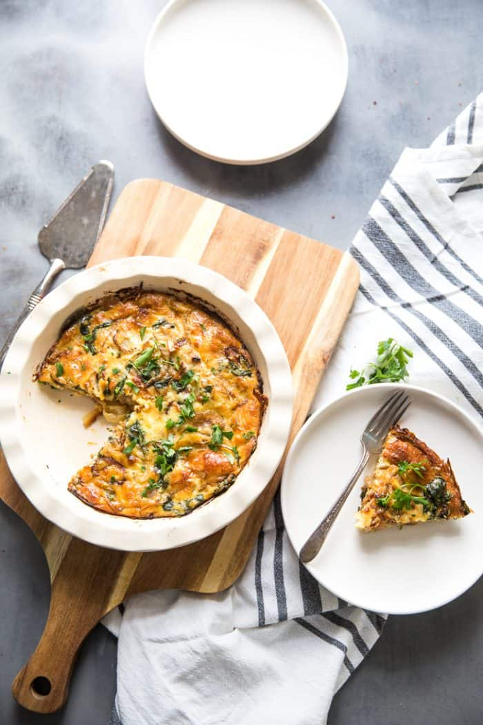 Spinach Quiche with plate and slice on the side