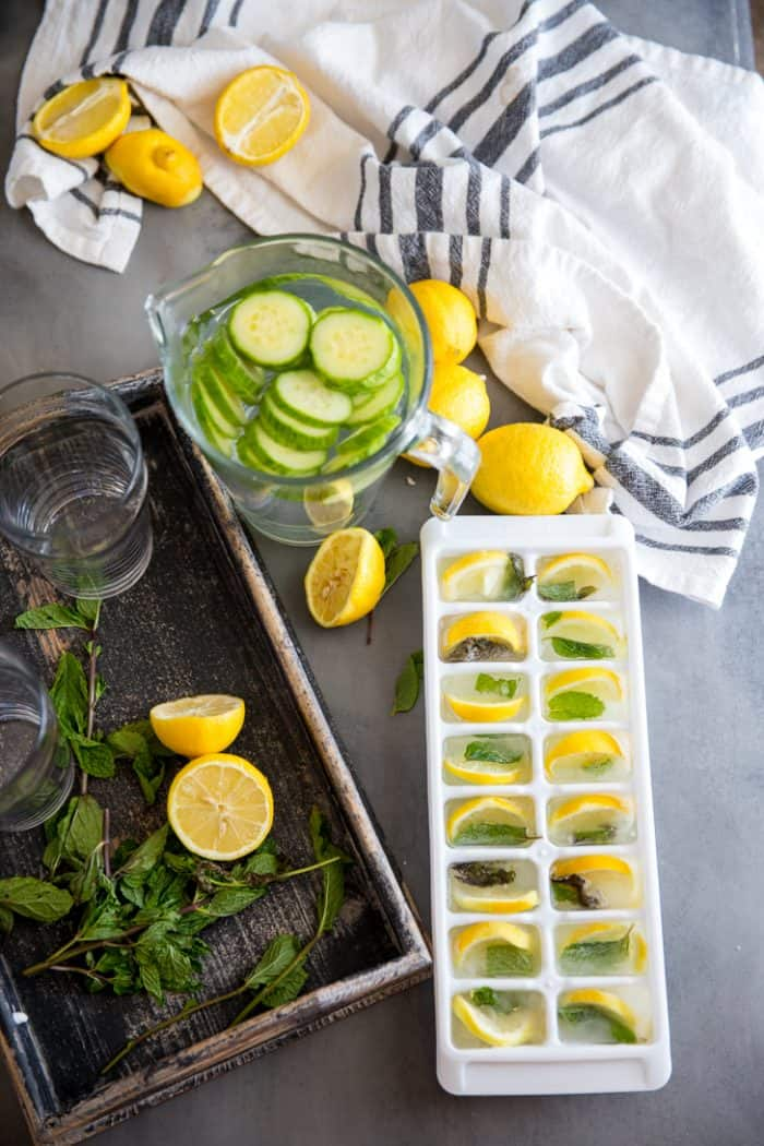 Cucumber lemon detox water pitcher with ice cubes