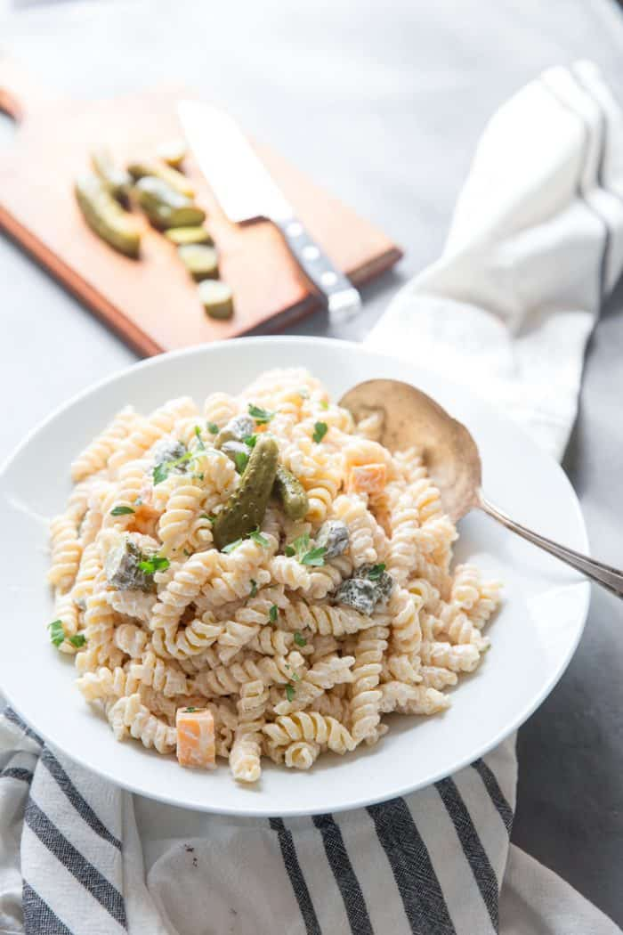 dill pickle pasta salad with serving spoon