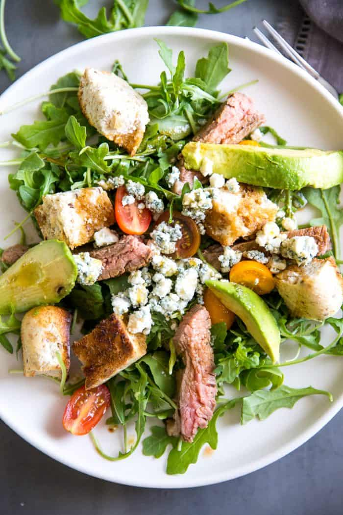 Black and blue steak in a salad