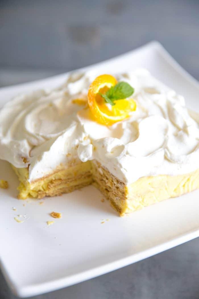 Orange creamsicle icebox cake with a slice cut