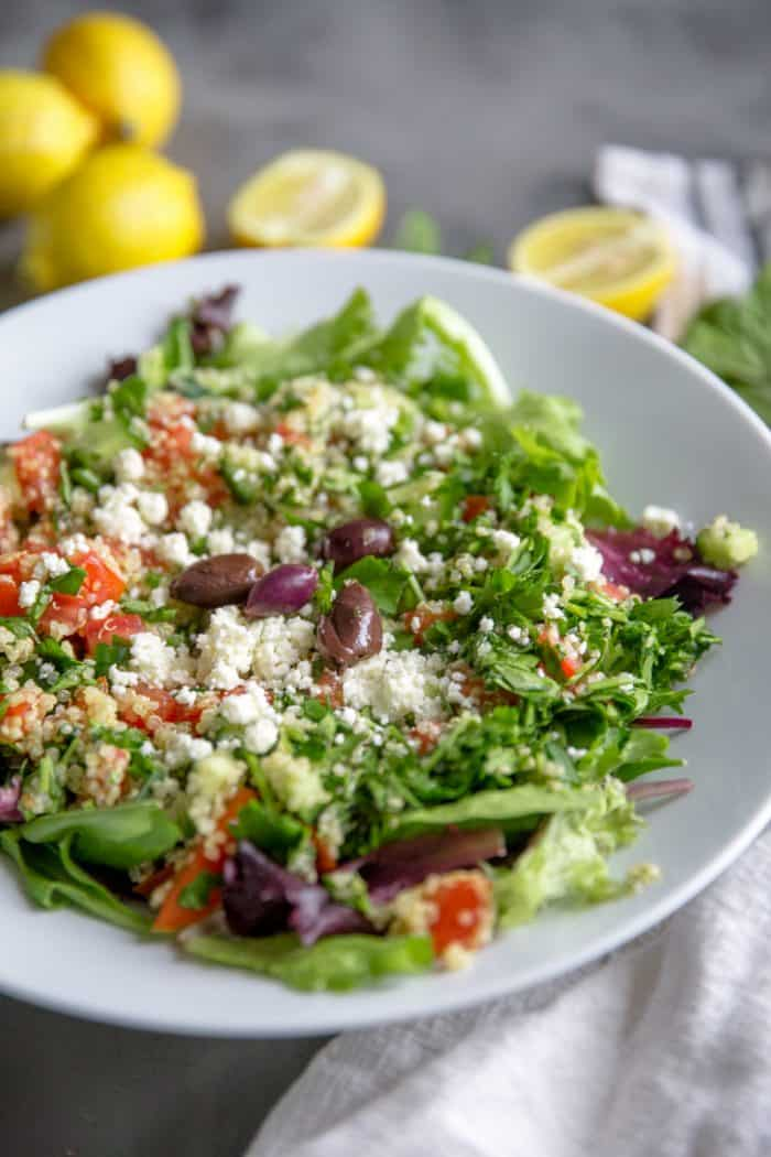 Quinoa tabbouleh salad with lemons on the side