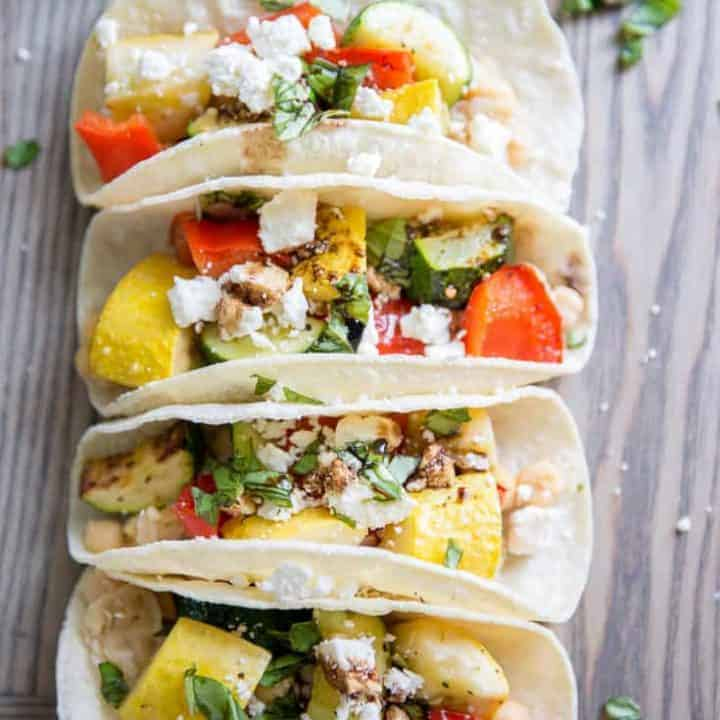 Roasted veggie tacos on a board