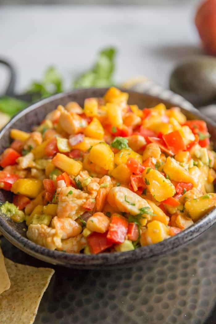 peach salsa in a brown bowl
