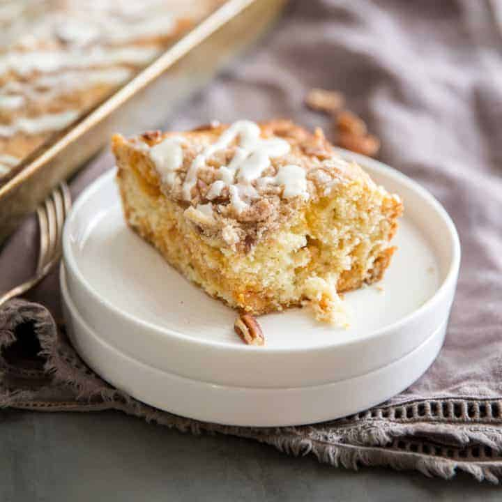Coffee cake with a piece on white plates!