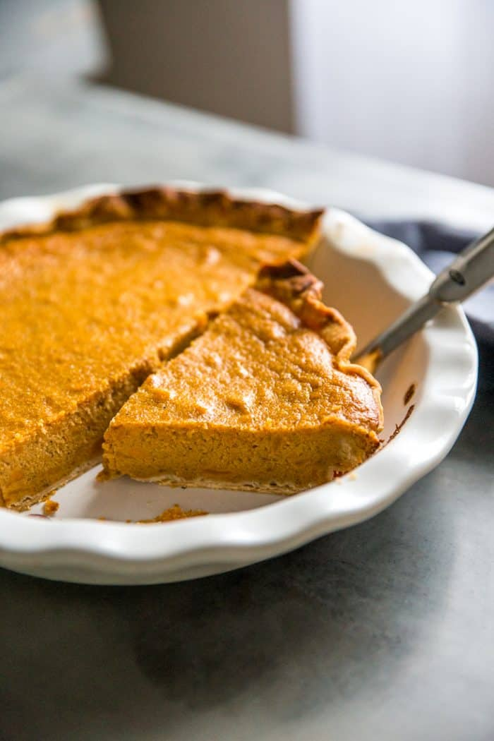 Homemade sweet potato pie half a pie and a piece