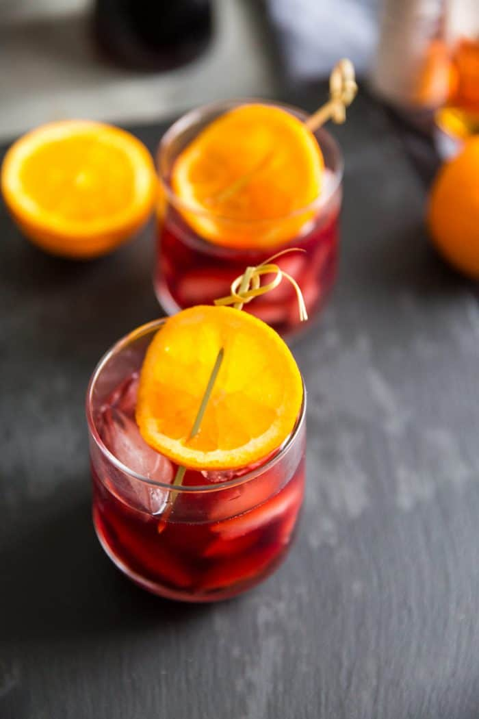 Pomegranate old fashioned with orange slices