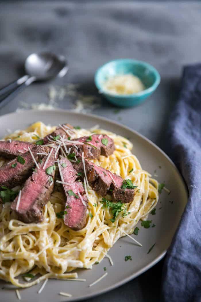 Steak alfredo over noodles
