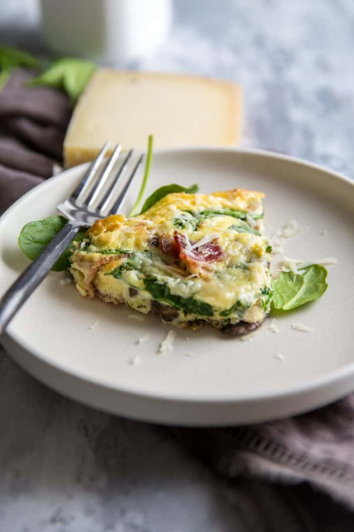 spinach frittata on cream plate