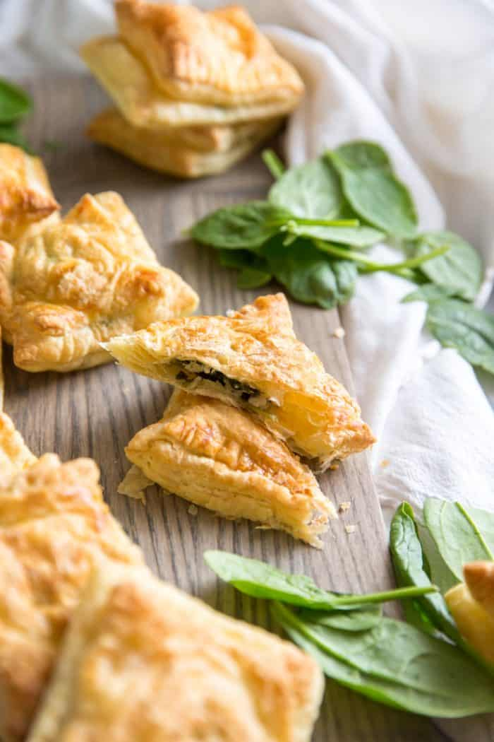 Spanakopita hand pies on a gray board