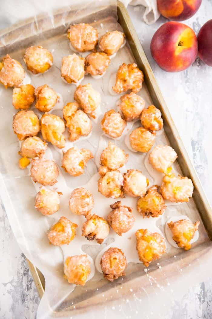 tray of peach fritters