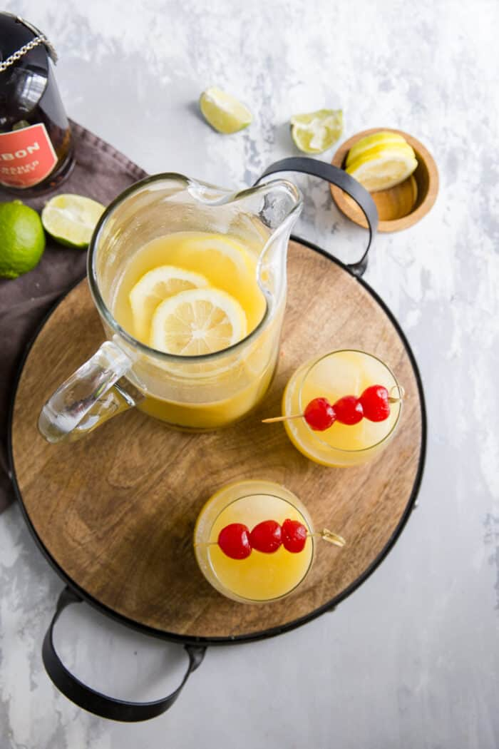 whiskey sour pitcher and two glasses