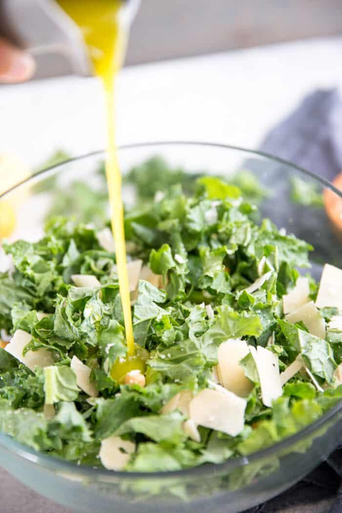 kale salad dressing pour