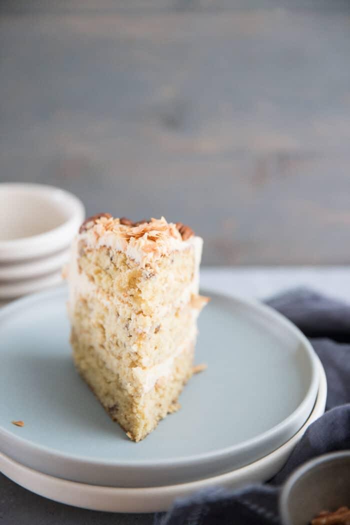 Italian cream cake slice on blue plate