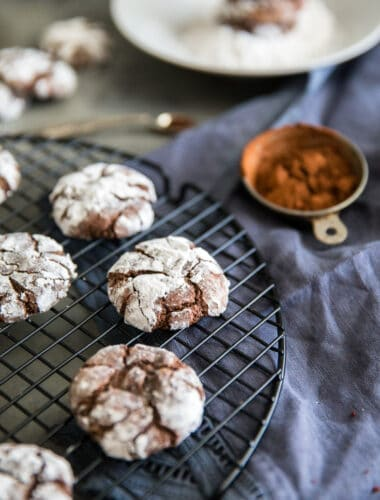 chocolate crinkle cookies side of cocoa powder