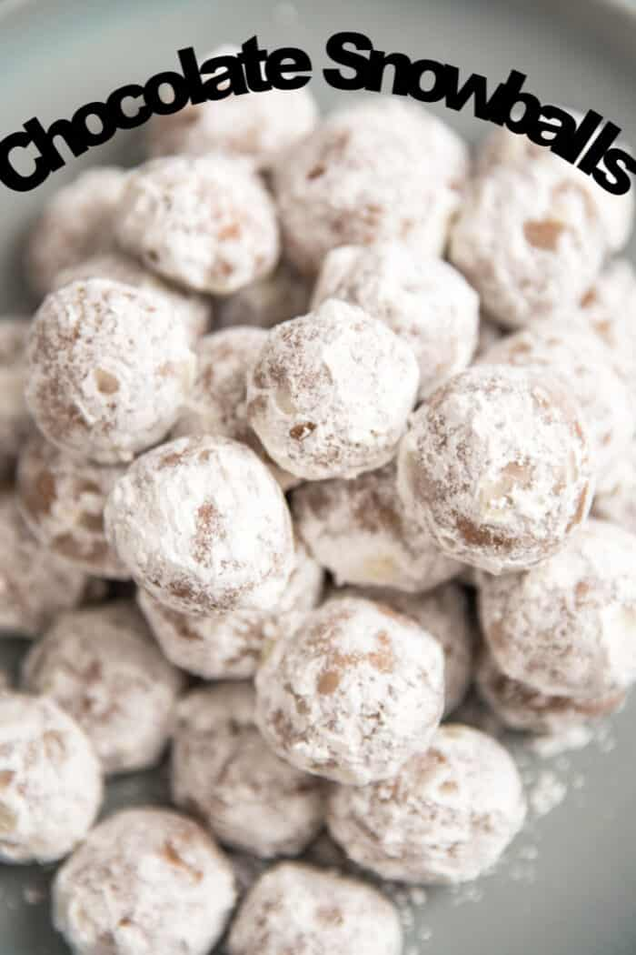 A close up of chocolate snowball cookies