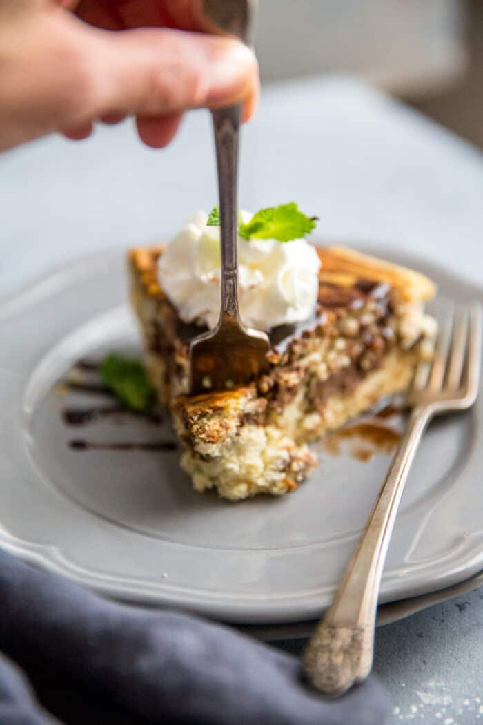 Tiramisu cheesecake fork taking a bite